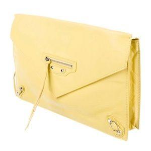 100% authentic Balenciaga yellow clutch